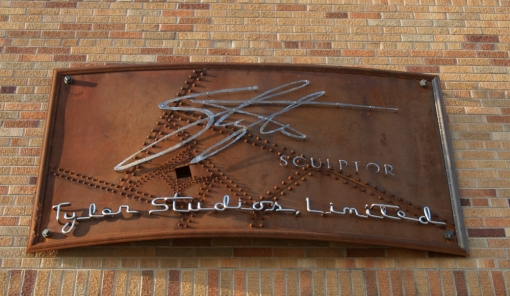 Studio Sign, Mequon Road, 2007. Riveted rusting steel and stainless steel. Photo by artist.